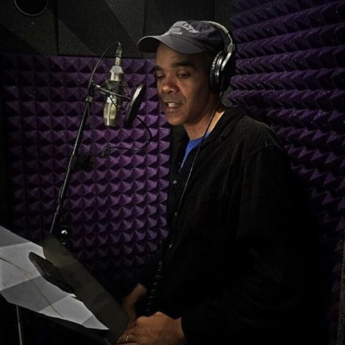 A man recording a narration inside of his WhisperRoom vocal booth