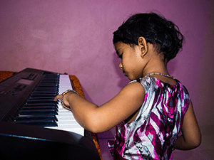 Young girl playing the keyboard