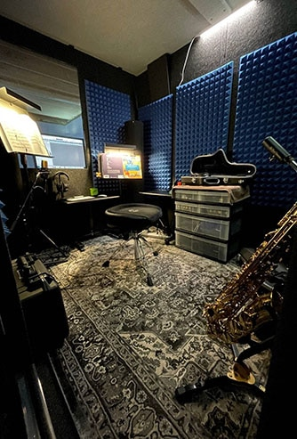 The interior of WhisperRoom's MDL 7296 S set up for saxophone practice.