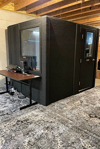 WhisperRoom's MDL 7296 S setup for practice in a home's basement