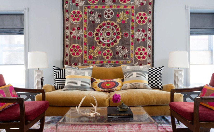 image of a living room with a sofa and carpet hanging on the wall
