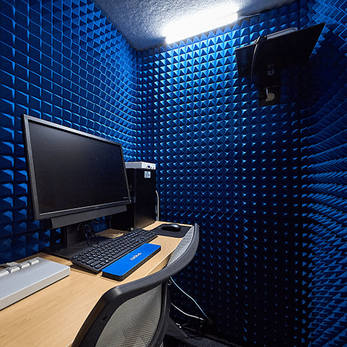 A computer on a desk inside of MTSU's psychology department's WhisperRoom testing booth.