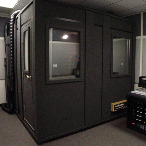 A WhisperRoom sound booth shown in an audio mixing room.