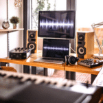A home recording studio with monitors, speakers, and other various recording gear